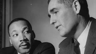 The Rev. Martin Luther King Jr. talks with