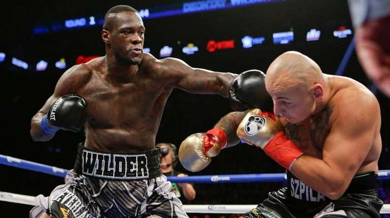 Deontay Wilder punches Artur Szpilka during the first
