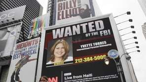 A video billboard featuring fugitives wanted by the