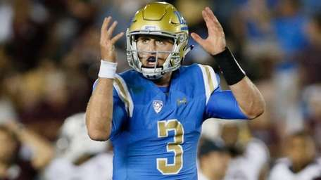 UCLA quarterback Josh Rosen gestures as if he