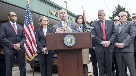 Nassau County police Commissioner Patrick Ryder is joined