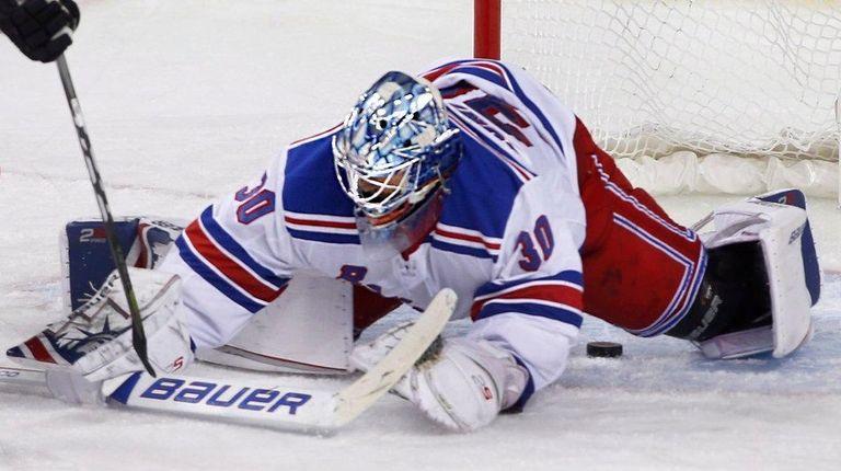 Rangers goalie Henrik Lundqvist, right, makes a save
