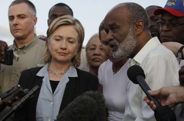 Haiti's President Rene Preval, right, answers questions from