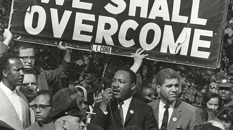 The Rev. Martin Luther King Jr. addresses a
