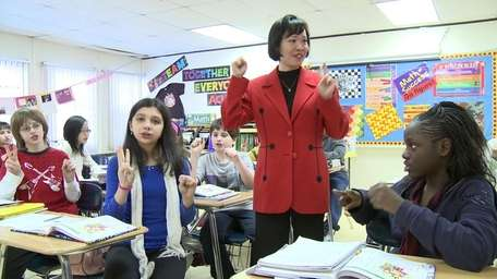 Ying Yhang, Chinese teacher, teaches her class of