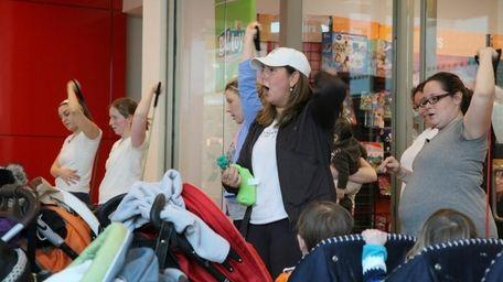 Beth Kichel, center, leads participants in Stroller Strides