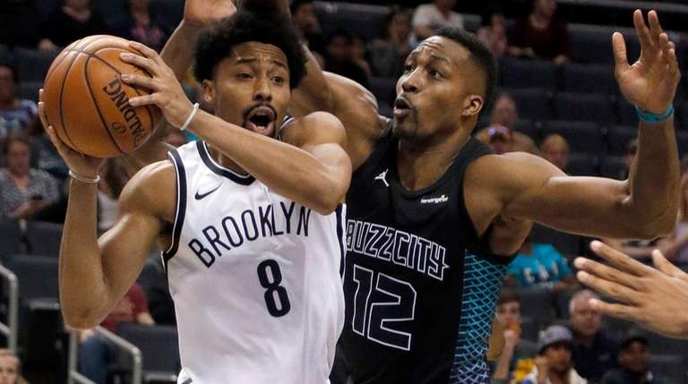 The Nets' Spencer Dinwiddie looks to pass the