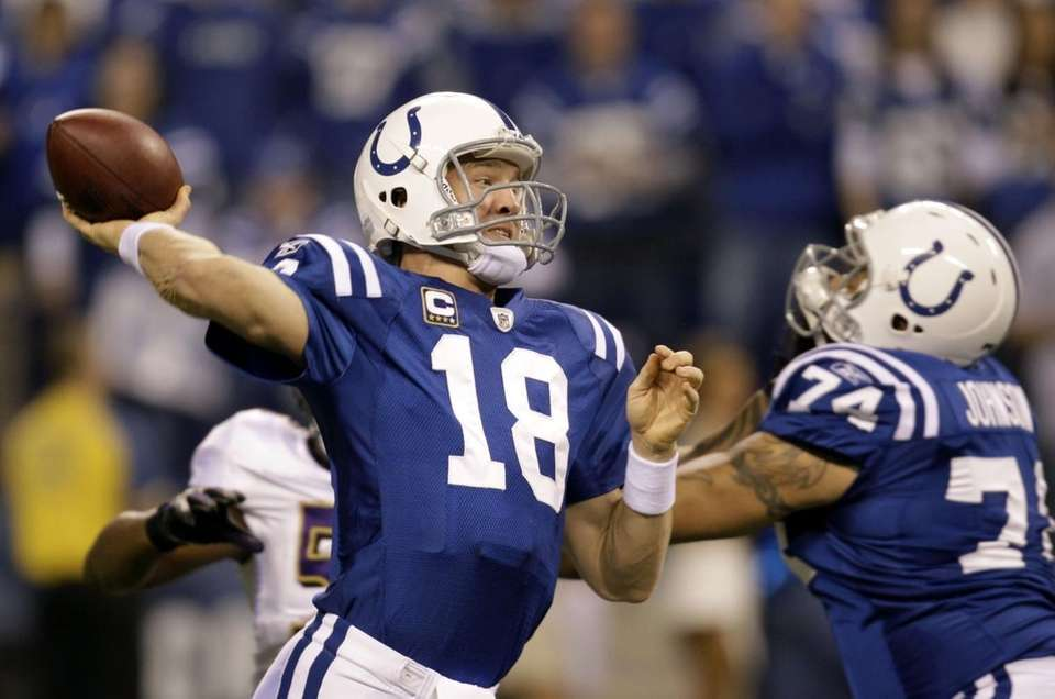 Indianapolis Colts quarterback Peyton Manning (18) throws a
