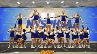 East Meadow cheerleaders compete in the NYSPHSAA Cheerleading