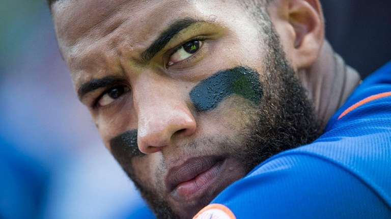 Mets infielder Amed Rosario watches during a spring