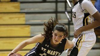 St. Mary's Lily Rakitzis (10) drives the baseline