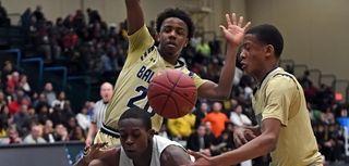 Baldwin Tre Riggins (20) fouls Uniondale in the