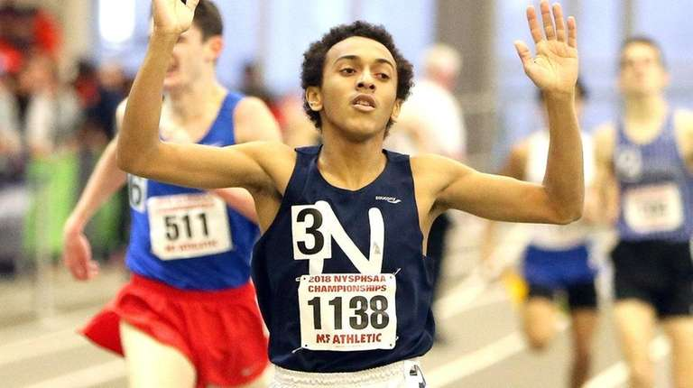Isaiah Claiborne of Northport wins the boys 1,000-meter