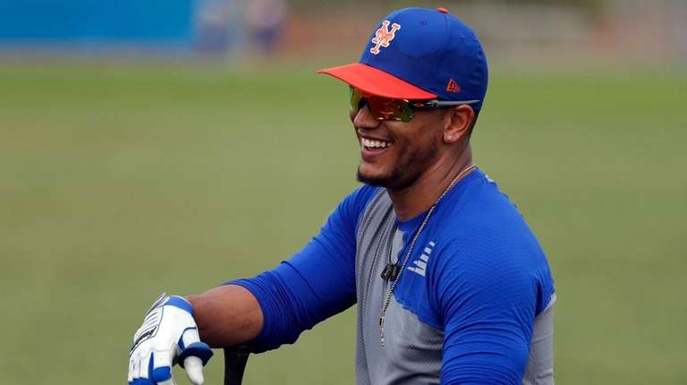 The Mets' Juan Lagares smiles as he waits