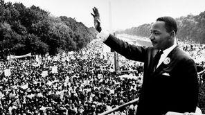 The Rev. Martin Luther King Jr. (1929-1968) addresses