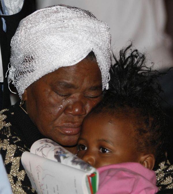 Christiane Surpris holds her granddaughter Devaria emmannel, 4,