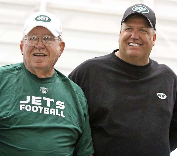 Buddy Ryan, left, with son Rex.