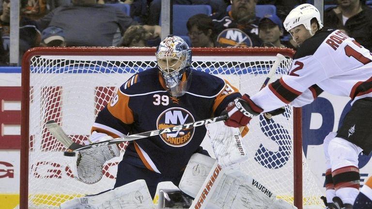 Islanders goalie Rick DiPietro (39) stops a shot