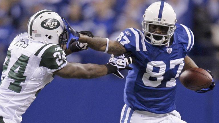 Colts receiver Reggie Wayne tries to run past