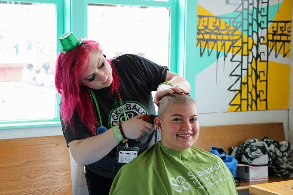Nicole Romero, 24, has her head shaved to