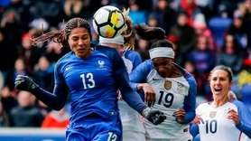 France's Valerie Gauvin (L) kicks the ball during