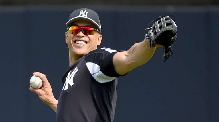 Yankees' Giancarlo Stanton works out on the field