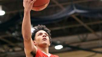 Amityville's Joshua Serrano with the layup during the