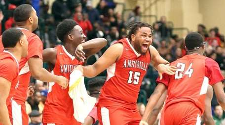 Amityville celebrates its 77- 69 win over Hills