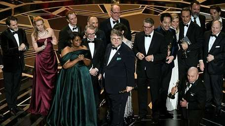 Mexican director Guillermo del Toro with his cast