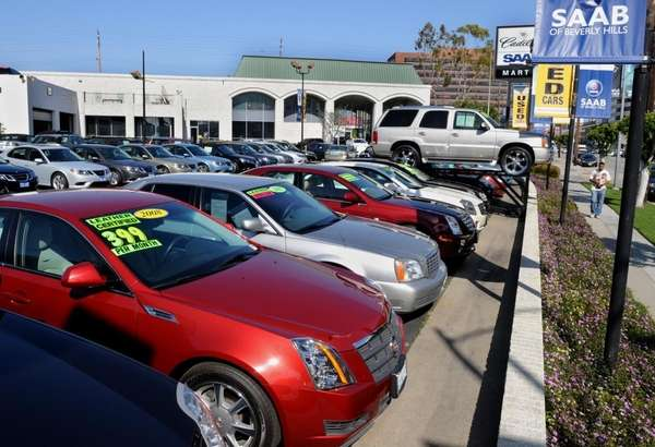 (FILES)Cars manufactured by General Motors, which include Cadillacs,