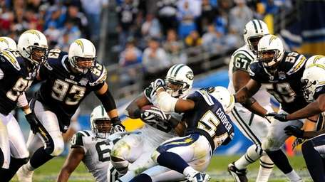Chargers linebacker Stephen Cooper, right, says the Jets'