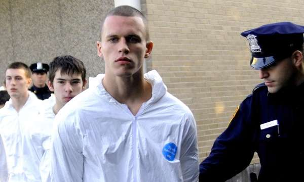 Jeffrey Conroy, 17, is led out of a