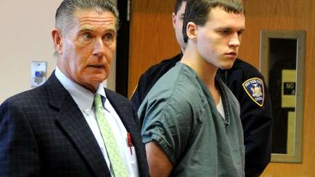 Jeffrey Conroy stands next to his lawyer, Bill