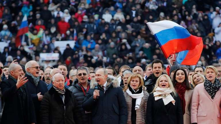Russian President Vladimir Putin, center, and other guests