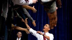 President Barack Obama greets the crowd prior to