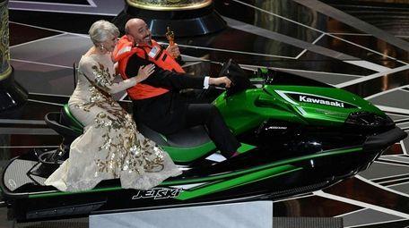 Helen Mirren and Mark Bridges, the winner of