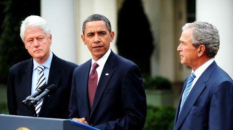President Barack Obama, flanked by former Presidents George