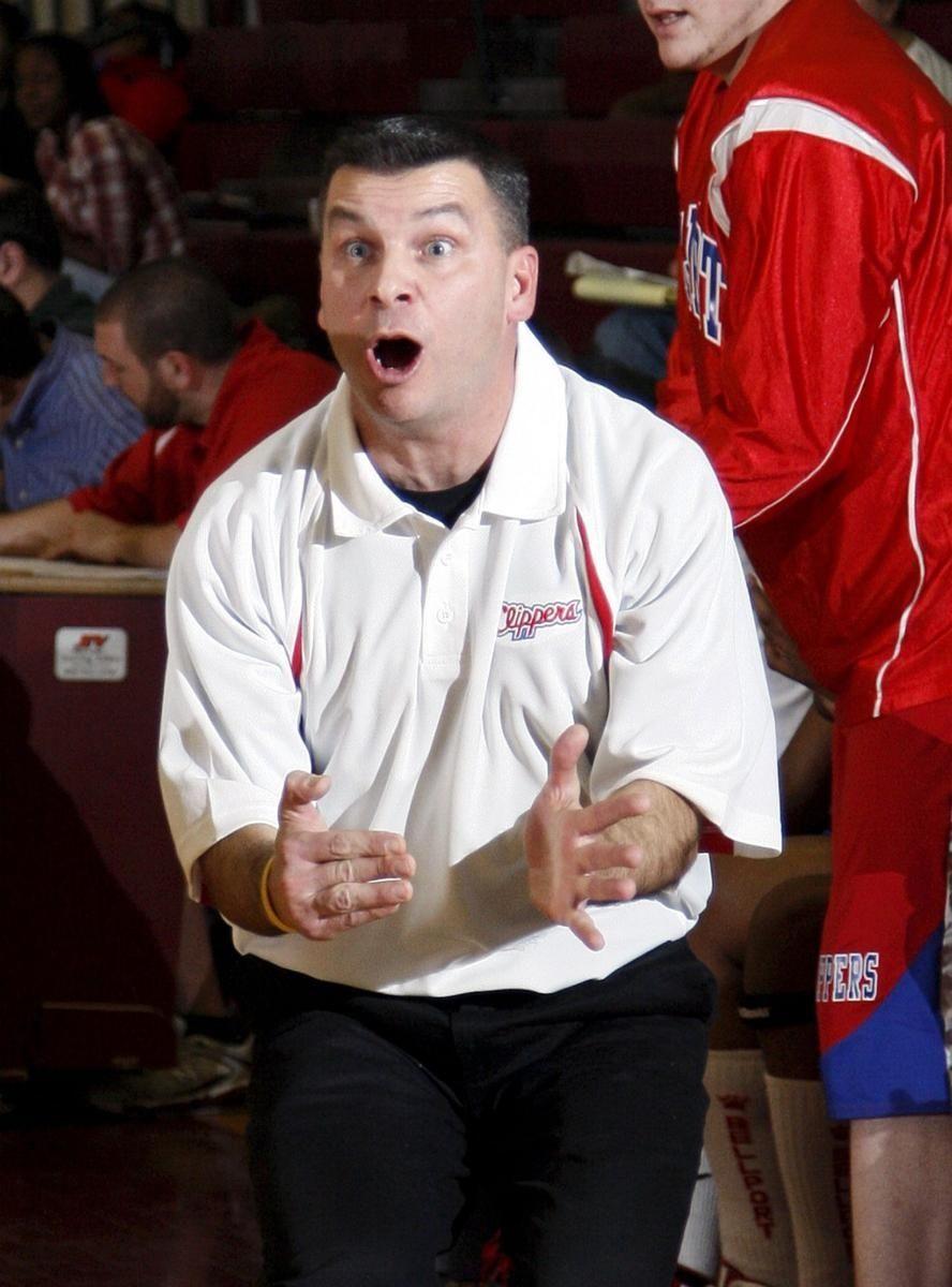 Bellport's head coach Peter Grossi tries to get