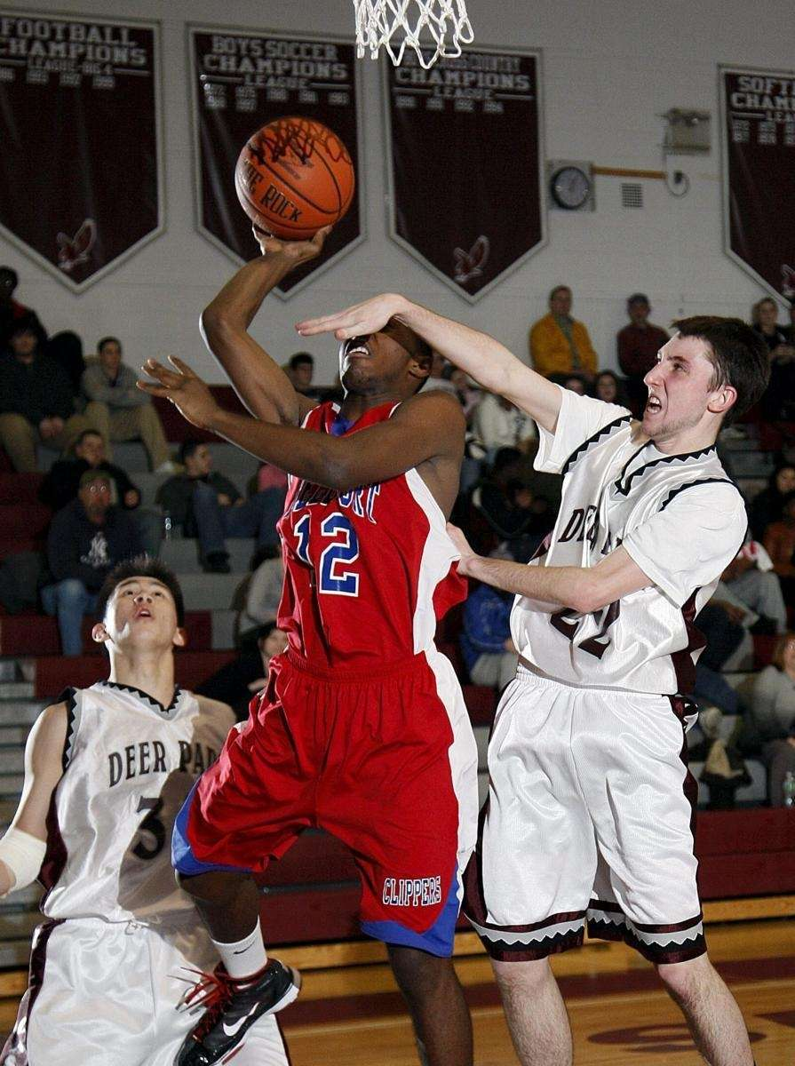 Bellport's Armand Correa (12) is fouled hard going