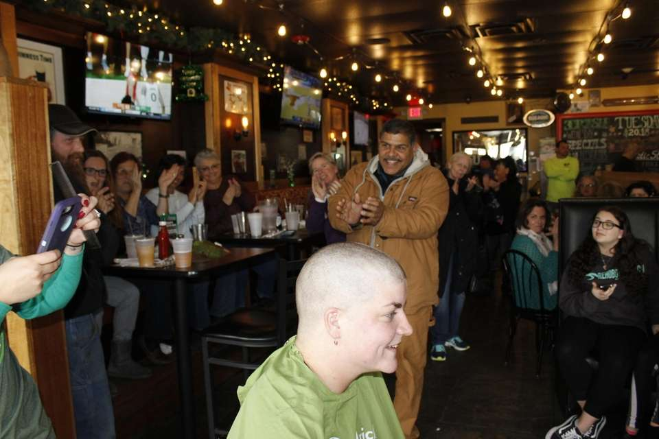Onlookers at Fulton's Irish Pub in Patchogue cheered