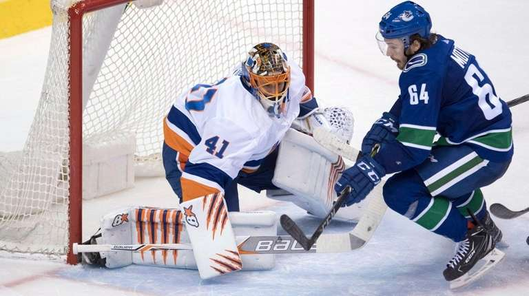 Islanders goaltender Jaroslav Halak stops a shot from
