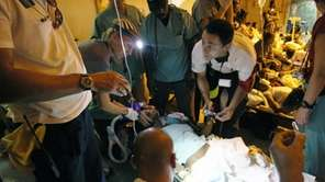 A Haitian injured quake survivor is treated at