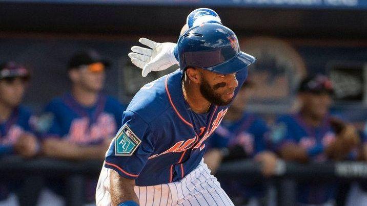 Mets infielder Amed Rosario runs toward first base