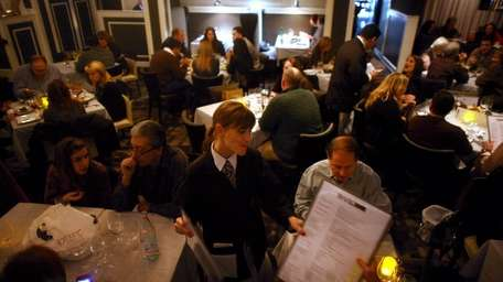 People dine in the RARE650 restaurant in Syosset.