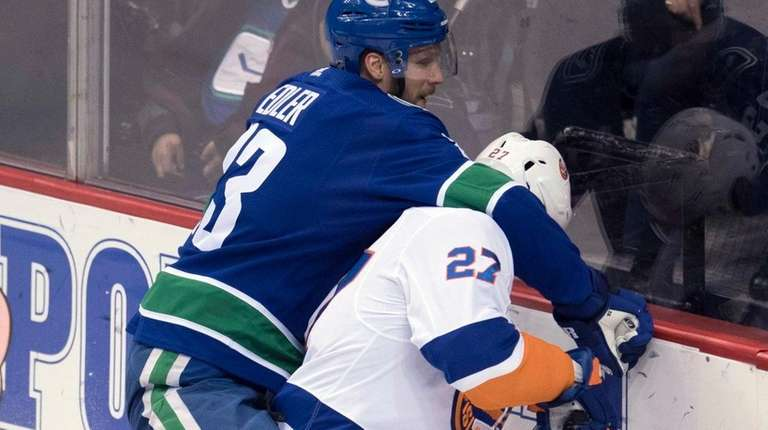 Vancouver's Alexander Edler fights for control of the