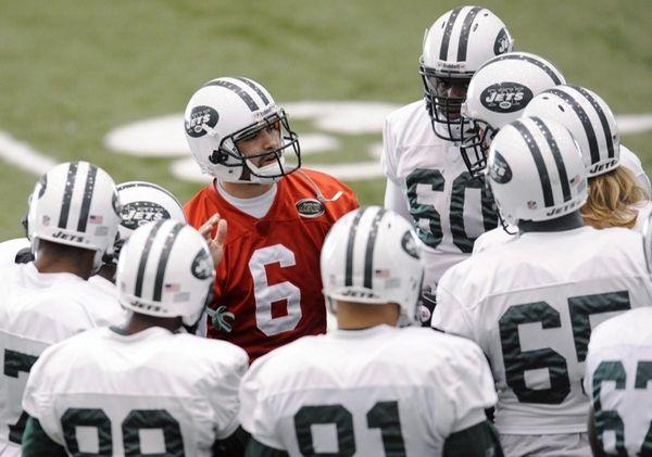 New York Jets quarterback Mark Sanchez (6) talks