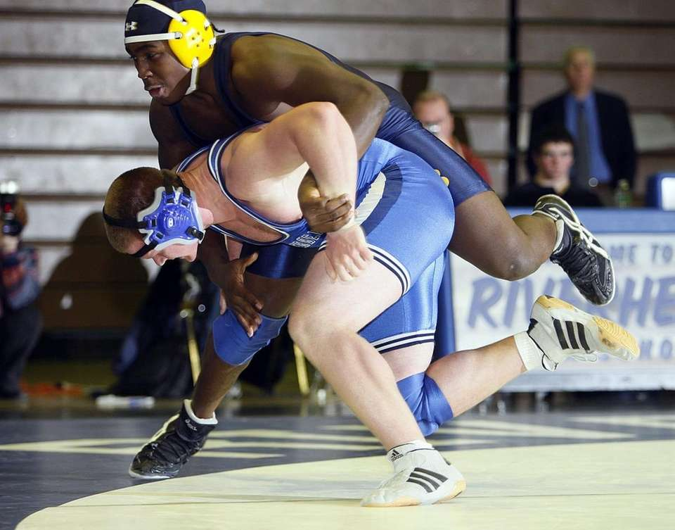 West Babylon's Reggie Robinson controls Riverhead's Chris Blank