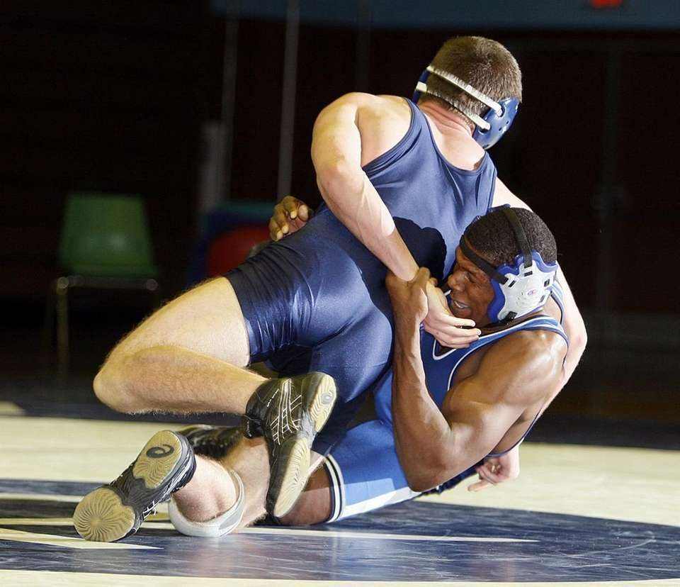 Riverhead's Devon Richard (bottom) fights to control West