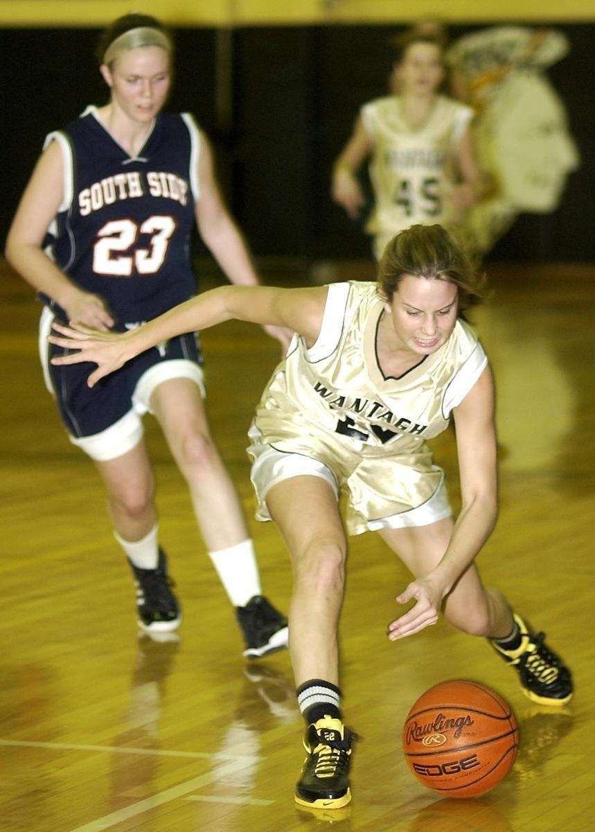 Wantagh's Paula Schmidt (22, right), tries to get