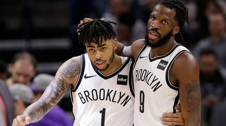 Nets' D'Angelo Russell, left, and DeMarre Carroll